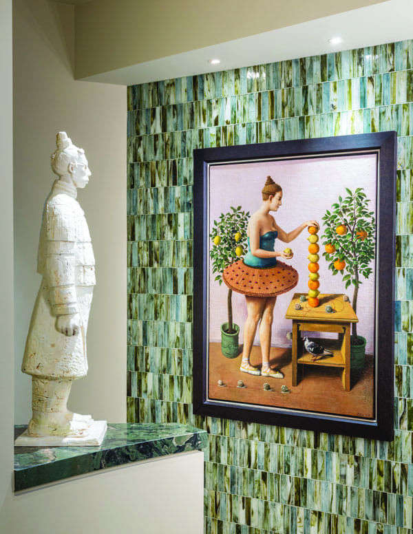 A ceramic sculpture by Wanxin Zhang and a painting by Illya Zomb give a guest bathroom a playful vibe.