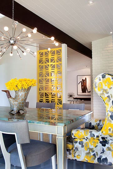 The Sputnik chandelier features clear crystal spheres and round bulbs for a fresh pop of contemporary glamour. A one-of-a-kind vase by artist Daric Harbor from the Galleria in Palm Springs adds whimsy.