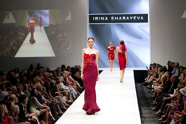 Designer Irina Shabayeva is quickly becoming a big name in fashion. Born in the Republic of Georgia and raised in Brooklyn, N.Y., Shabayeva graduated from Parsons School of Design in 2003 to pursue a career in the fashion industry. While at Parsons, she was honored with the Saga Design Award among others. Saga allowed her to study fur design in Denmark. She went on to work for Adrienne Landau as head designer. In 2009, Shabayeva competed, and won, Project Runway Season 6. Since that time, she has been growing her brand. In 2011, the designer launched an exclusive bridal collection for Kleinfeld, and now has a budding bridal business. That same year, she launched a line called LUXE by Irina, sold exclusively on the Home Shopping Network (HSN). She continues to design for celebrity clientele, which includes Madonna, Selena Gomez, and Carrie Underwood, to name a few.