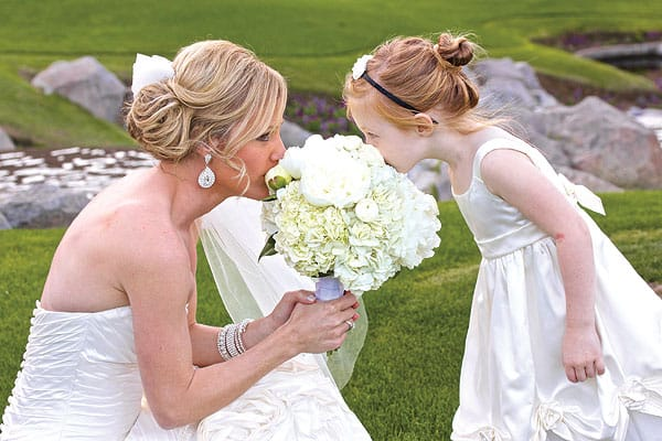 Hot tips for cool desert weddings - Keep your little flower girl cool, too, with a sweet ballerina bun that stays neat and tidy day to night.