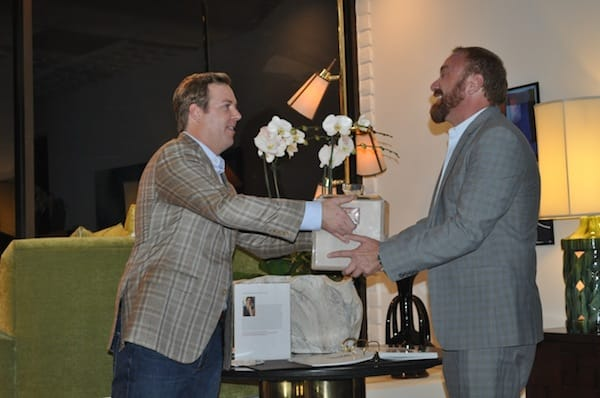 Christopher Kennedy gives a parting gift to outgoing president Troy Zimmerman of the Palm Springs chapter of the American Society of Interior Designers.