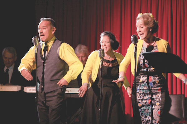 Singers (from left to right) Charles Herrera, Francesca Amari, and Darci Daniels perform in On The Air! An Evening of Live Radio Show Classics. The trio sang jingles for the event sponsors in the style of '40s music.