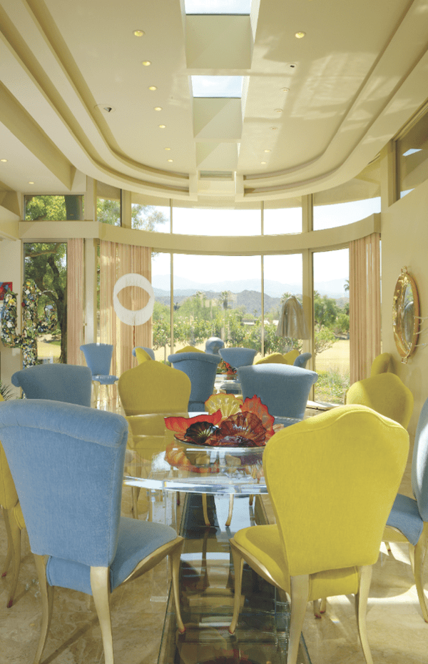 In the dining room, colorful glass on the tables and immersed in water installed in strips under the floor by Dale Chihuly, a ceramic cactus by Terrie Read Kvenild, and other artwork blend seamlessly with the views beyond.
