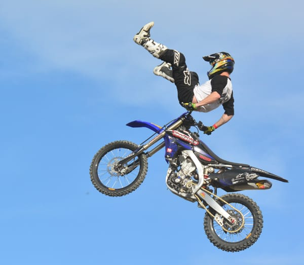 Freestyle Motocross awes the crowd with high jumps and tricks.