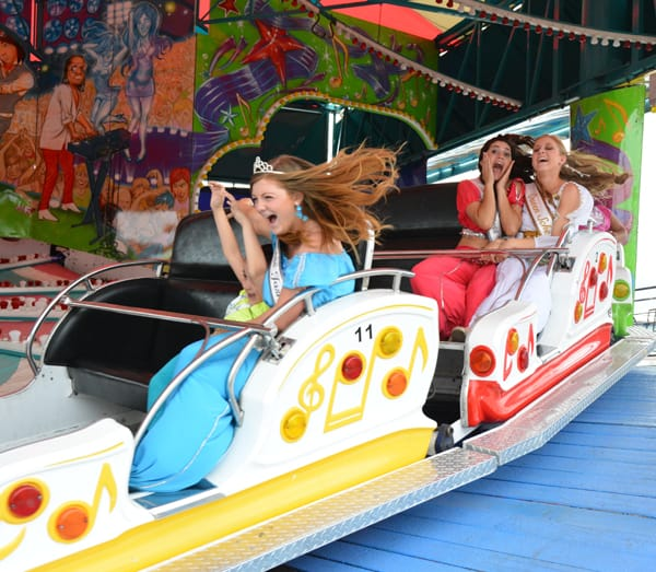 Former Queen Scheherazade and her court take a ride in the carnival.