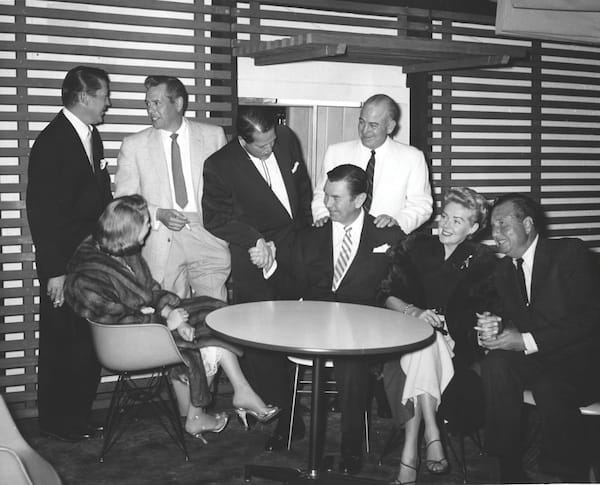 (Standing, from left): Russell Wade, Desi Arnaz, William Cody, and an unidentified man. From left, seated: Mr. and Mrs. George Cameron and Mr. and Mrs. Phil Harris.