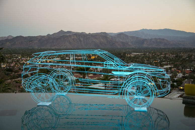 Land Rover Range Rover Evoque fluorescent wire frame floating in the Hugh Kapture designed Siva House in Palm Springs