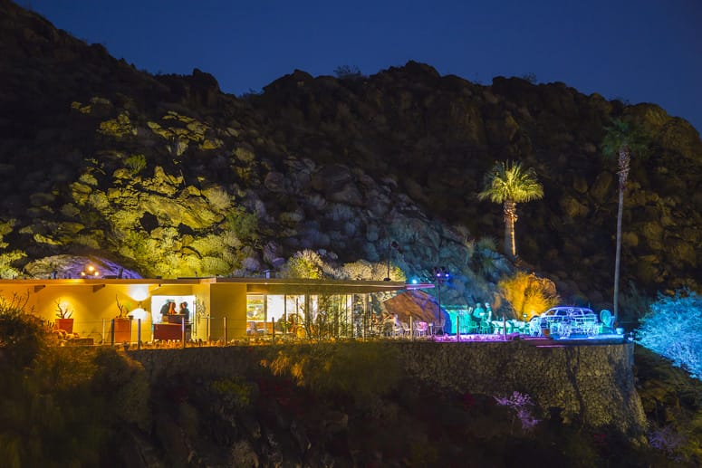 The Hugh Kapture designed Siva House in Palm Springs at a distance with the wire frame illuminated.