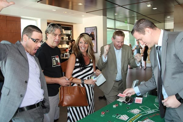 Casino-style games were just part of the fun at Day of Beauty. (From left) Jason Roloff of Galderma, manufacturer of Sculptra, Dysport, Restylane, Perlane and Restylane Silk; Doug and Gail Prosise; Matthew Thayer of Allergan; and Justin Welch of Syneron-Candela.