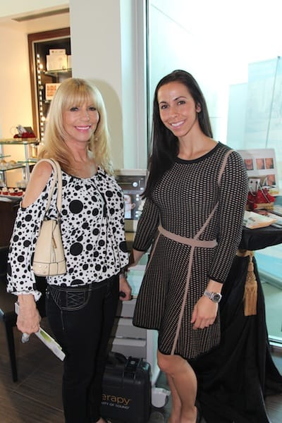 Fran Pomponio (left) talks with Carla Dolomont, representative for Ultherapy, ultra sound face and neck lifting.