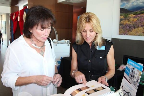 Deanna Pangracs of Zeltiq, manufacturer of CoolSculpt, talks with Bobbie Fritz (left).