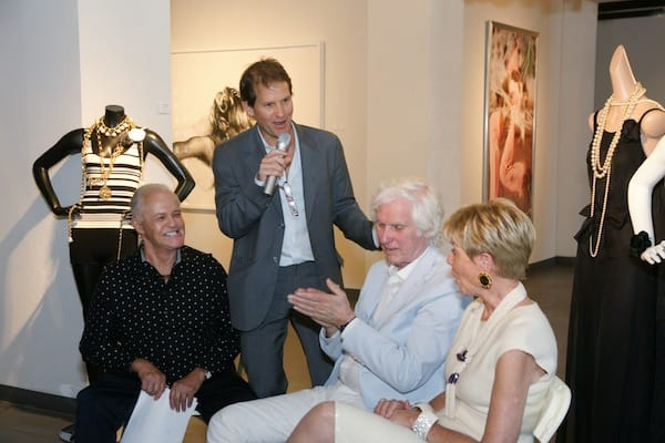 Palm Springs Life Publisher Frank Jones introduces the panel of (from left) Michael Childers, Douglas Kirkland, and Donna MacMillan.