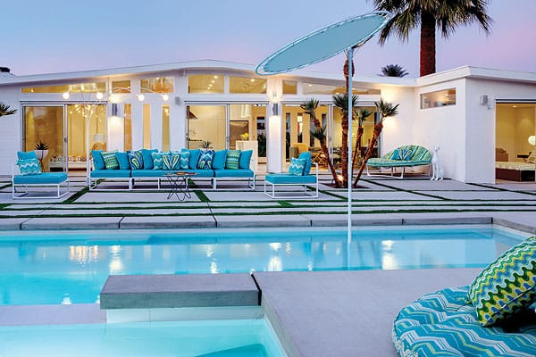 Out back, an elevated spa spills into the lengthy saltwater pool, where a tanning shelf runs along one side. Submerged just 1 foot underwater, the ledge makes a popular place to sunbathe on loungers placed right in the pool.