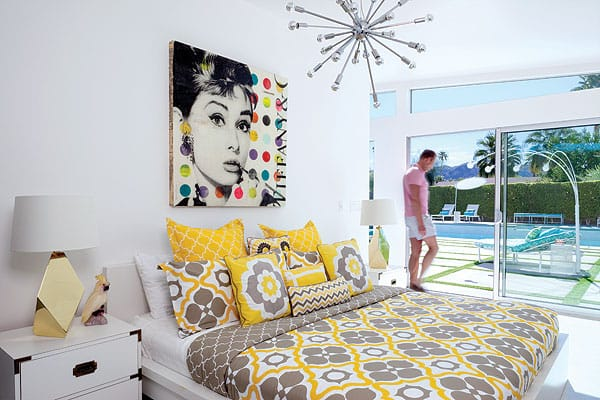 Sigurdson added sliding doors in both master suites, making indoor-outdoor living a breeze. A second sputnik chandelier and brass accents keep the look consistent throughout the home.