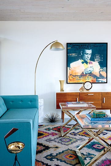 The midcentury-style tongue-and-groove ceiling that Sigurdson added to the 1953 home takes guests back in time when paired with vintage furnishings and accents.