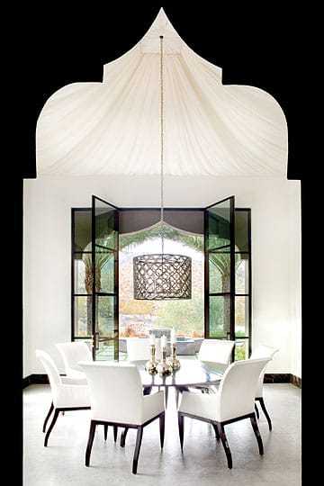 The graceful billowing of the draped ceiling in the dining room conjures the feeling of stepping inside a Moroccan tent where a meal fit for royalty awaits.