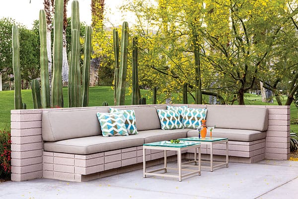 "We used tall cacti to create a sense of intimacy around this seating area,"" Purnel says of a client's home whose back patio sits along a golf course."