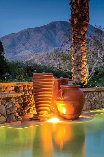 A trio of bubbling pots are contemporary in their minimalism yet make an appropriate poolside water feature for one of Purnel's clients, whose home is in a traditional Spanish style.