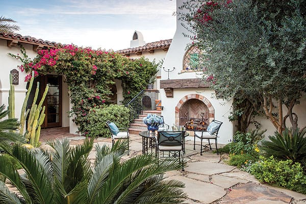 Desert plants mingle with shrubs and flowering bougainvillea in this inviting residential courtyard by Randy Purnel.