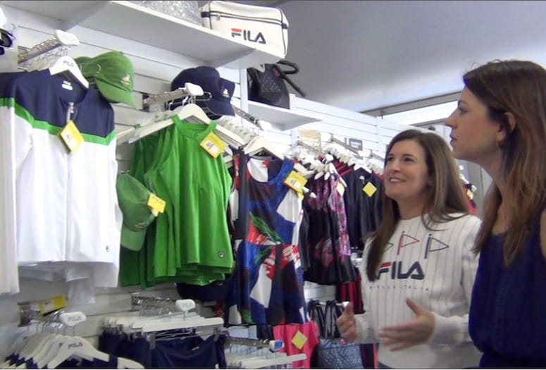 Shoppers in Fila Sporting Goods store.