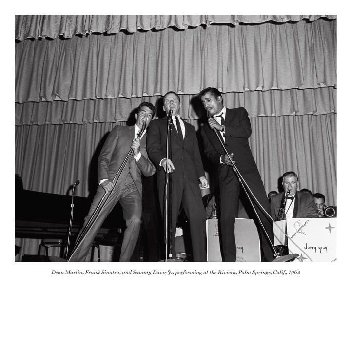 Dean Martin, Frank Sinatra, and Sammy Davis Jr. performing at at the Riviera, Palm Springs, Calif., 1963