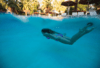 model swimming in pool