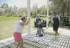 Club Fitter Golf Coach instructing student golfer